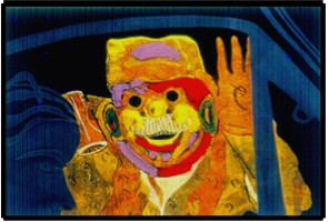 "FIGURE 44: DUNCAN LAURIE. ""MARDI GRAS IN VENEZUELA"". PAINT AND GOLD LEAF ON CARVED GLASS"
